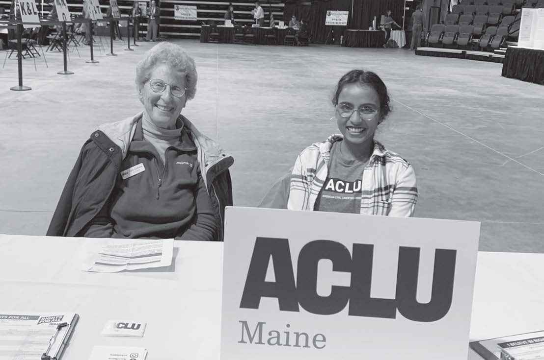 Dhivya Singaram, Engagement Coordinator/Organizer, and volunteer tabling at Bangor Polls