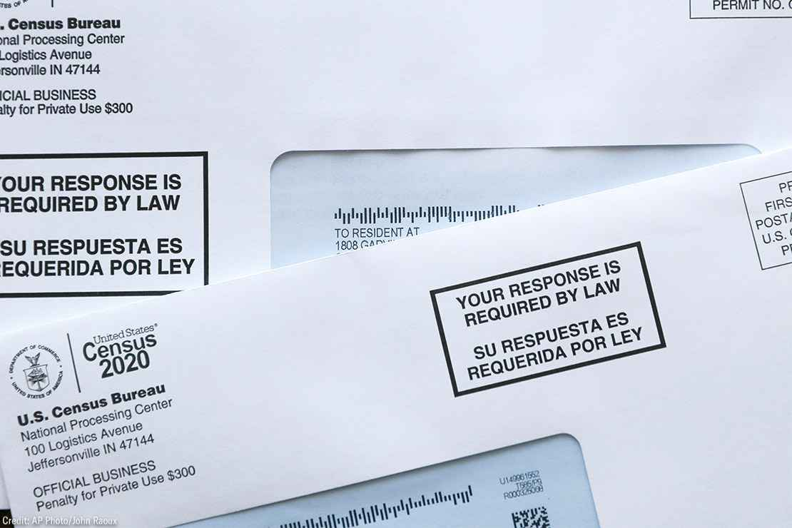 Two envelopes containing 2020 U.S. Census forms.