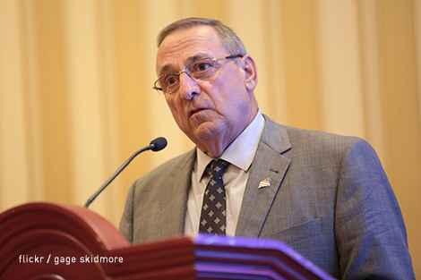 Gov. Paul LePage speaking at a podium
