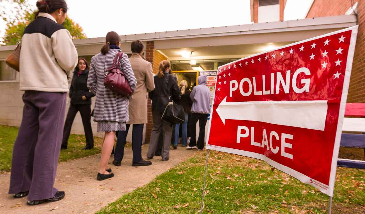 People lined up waiting to enter their polling place.