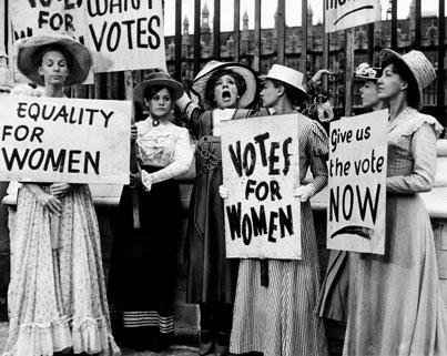 Women's suffrage activists holding signs about voting rights for women