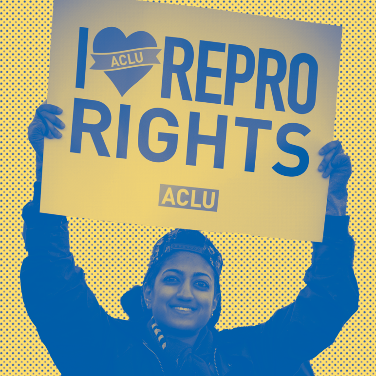 """Person holding a sign at a rally that says """"I Love Repro Rights"""""""