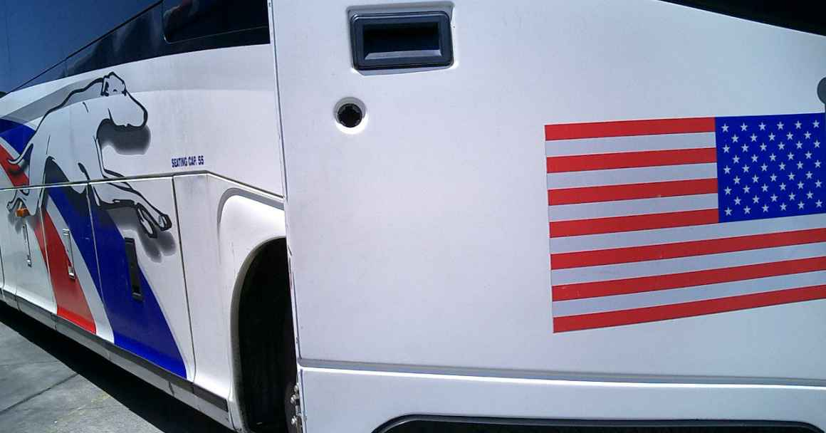 Greyhound bus with open door and American Flag decal